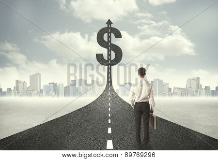 Business man on road heading toward a dollar sign concept
