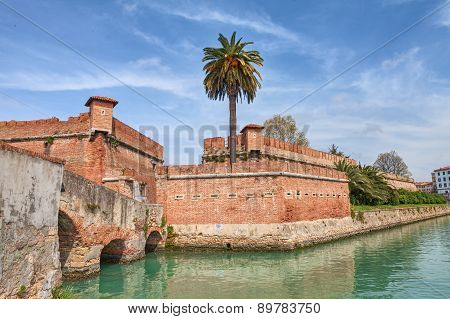 the old fortress Fortezza Nuova in Livorno, Tuscany, Italy, surrounded by a navigable moat. It was built to defend the city from attack by pirates poster