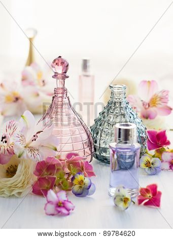 perfume and aromatic oils bottles surrounded by fresh flower poster