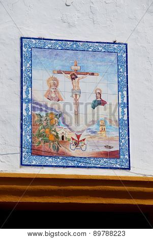 Crucifix on church wall, Marbella.