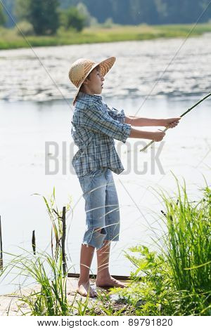 Surprised Angler Boy Is Throwing Bait Of Handmade Fishing Rod