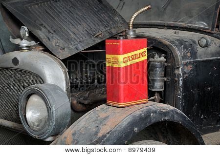 Vintage Retro Gas Can Isolated On Old Car