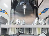 operator machining aluminum automotive parts by machining center poster