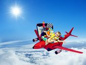Airplane Travel Baby Kid Packed Suitcase Child Flying inside Luggage Plane to Holiday Vacation over Blue Sky poster