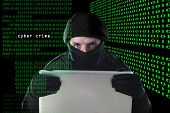hacker man in black using computer laptop for criminal activity hacking password and private information cracking password too access bank account data in cyber crime concept poster
