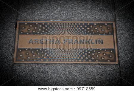 NEW YORK CITY, USA - SEPTEMBER, 2014: Aretha Frankling paving slab in front of famous Apollo theatre in Harlem New York City