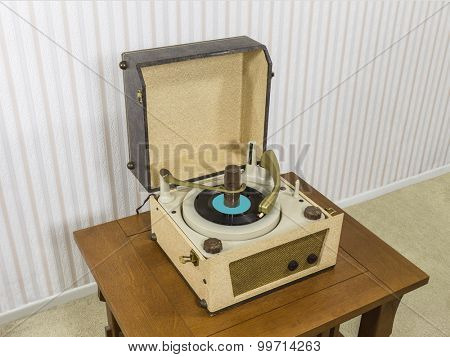 Vintage 1960's record player on wood table.