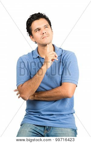 A handsome hispanic male in casual clothes with crossed arms finger under chin wondering concentrating imagining a thought or memory looking up and away. Vertical poster