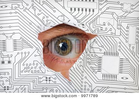 Eye Looking Through A Hole In Electronic Circuit