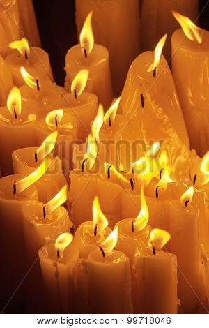 Bunch of candles burning at night