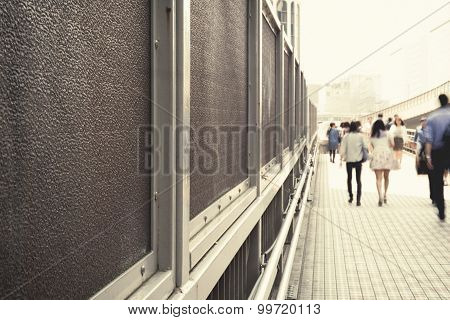 Vintage tone of city business people walking in the walkway blur motion