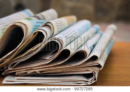 Newspapers on the table