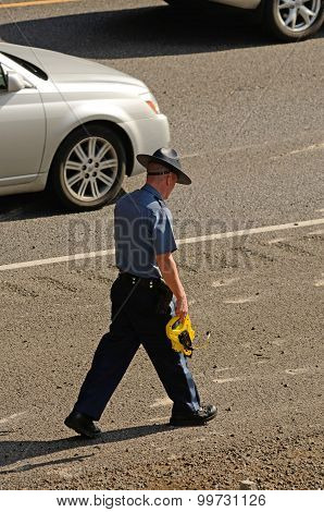A Oregon State Police Trooper investigating a motor vehicle