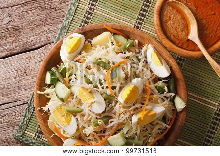 Traditional Indonesian Salad Gado-gado Closeup. Horizontal Top View
