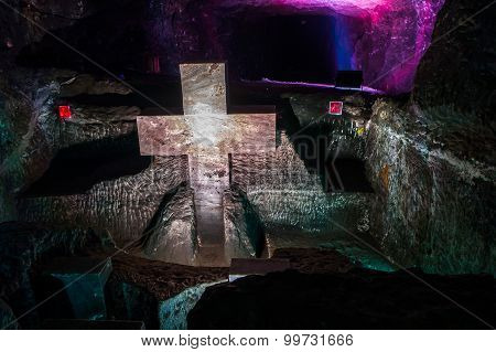Marble sculpture cross at underground Salt Cathedral Zipaquira built within the multicolored tunnels