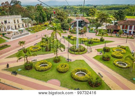 NATIONAL COFFEE PARK, COLOMBIA, Downward view of cable car path inside National Coffe Park showing p