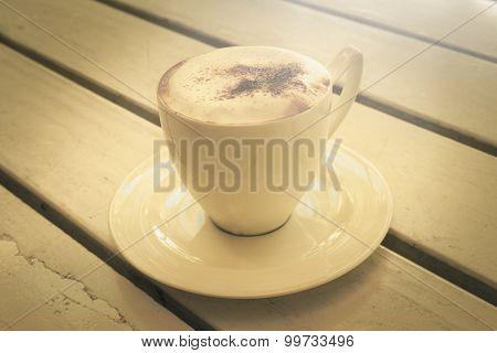 coffee Cappuccino in coffee shop vintage color tone