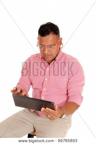 Closeup Of Man Working On Tablet Pc.