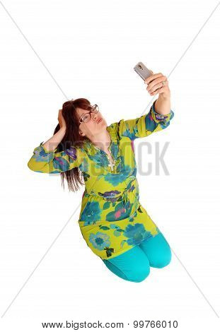 Woman Taking Selfie Kneeling.