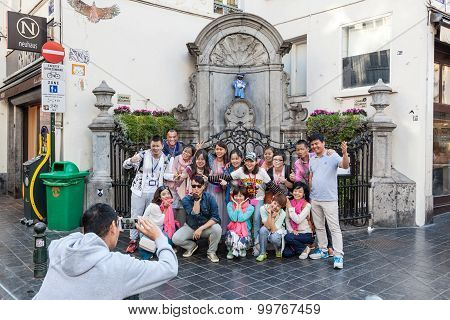 Chinese Tourists At The Manneken Pis Statue In Brussels