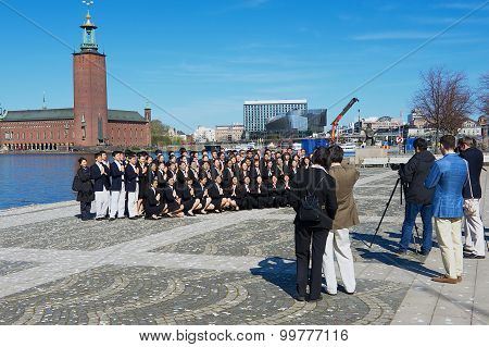 Asian tourists make group photo in Stockholm, Sweden.