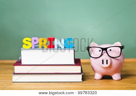 Spring Semester Theme With Textbooks And Piggy Bank