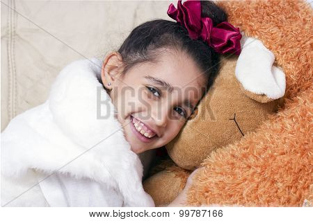 Little cute swarthy brunette girl