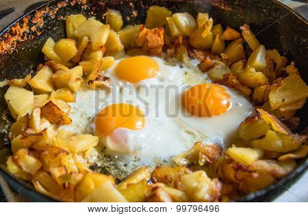 Fried Potatoes With scrambled eggs In Pan