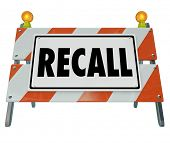 Recall word on a barrier or blockade warning sign to illustrate a car or automobile that is defective or dangerous and needs to be fixed or repaired poster