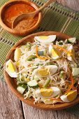 Gado Gado Indonesian vegetable salad close-up on the table. Vertical poster
