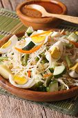 Indonesian salad gado-gado with peanut sauce close-up on a plate. vertical poster