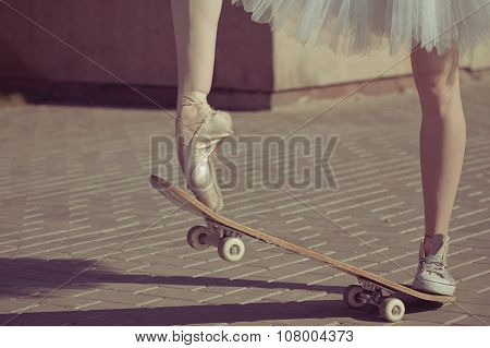 The Legs Of A Ballerina On A Skateboard.