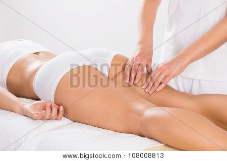 Female Customer Receiving Leg Massage In Salon