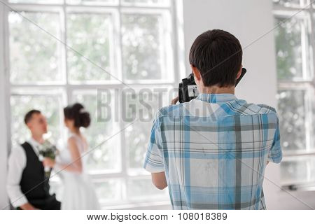 Wedding Photographer In Action