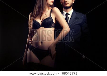 Woman In Underwear Next To Man In Suit