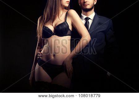 Woman In Underwear Next To Man In Suit