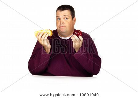 Man Thinking What To Eat Between A Chili Dog and an Apple