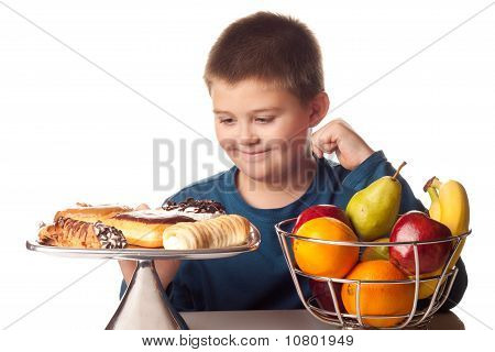 Boy Wanting A High Calorie Snack Over A Healthy Fruit