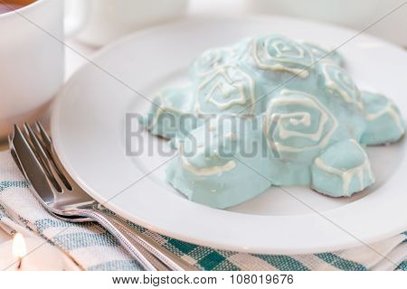 Turtle shapped cake on white plate