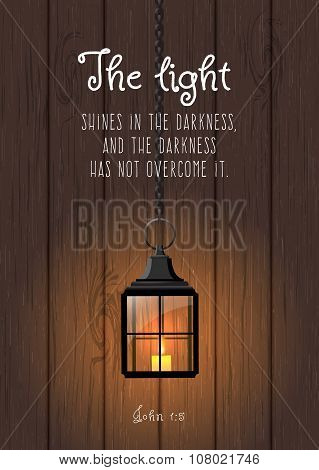 The light shines in the darkness... Biblical quote. Vintage shining lantern on wooden background, il