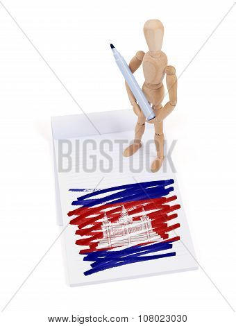 Wooden mannequin made a drawing of a flag - Cambodia poster