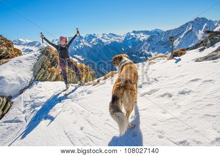 Girl Ski Touring In The Mountains With Dog