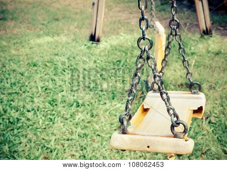 Musty hanging swing seats on park