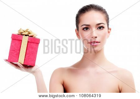 Pretty woman with a red gift box, isolated on white