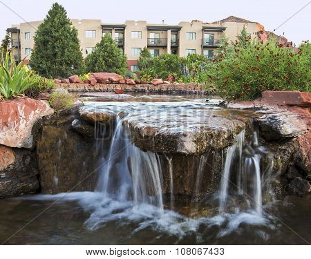 A Landscaped Water Feature By Some Condominiums