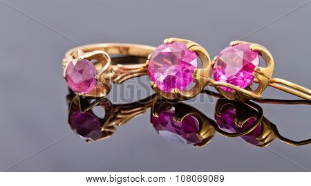 Set Gold Jewelry From Rings And Earrings With Alexandrite