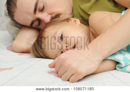 Father Holding ailing Baby Hands