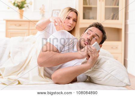 Husband and wife lying in bed