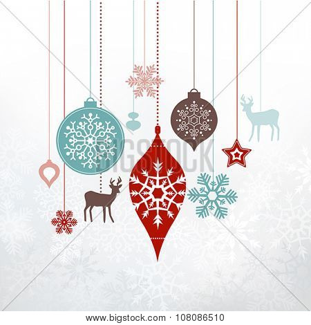 Christmas decorations, ornaments. Silver frosty background - frozen snowlfakes. Can be used as a greetings card.