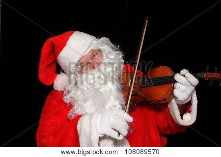 Santa Claus plays the Violin
